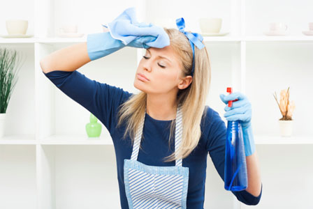 Woman stresssed from over cleaning