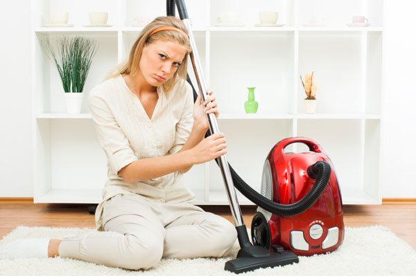 Woman upset with her vacuum