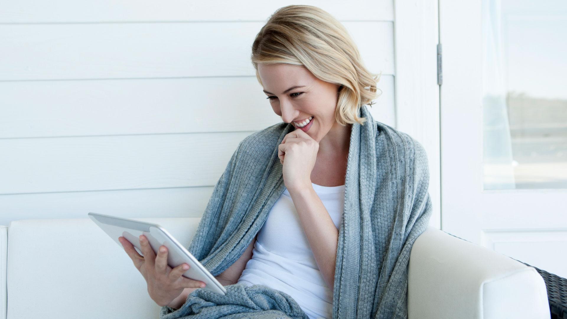 Woman watching uplifting video