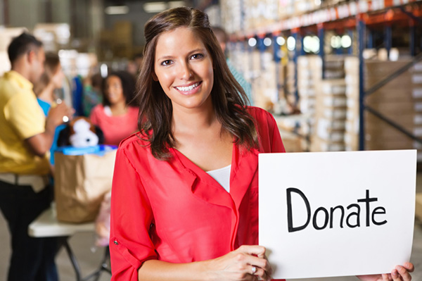 Woman with sign for donations