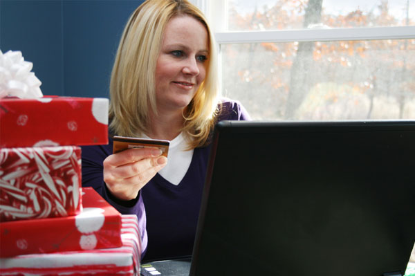 Woman with credit card shopping online