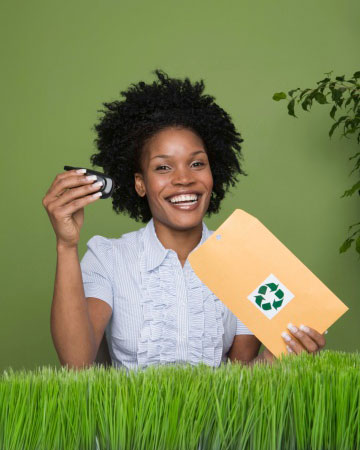 Young woman recycing old cell phone