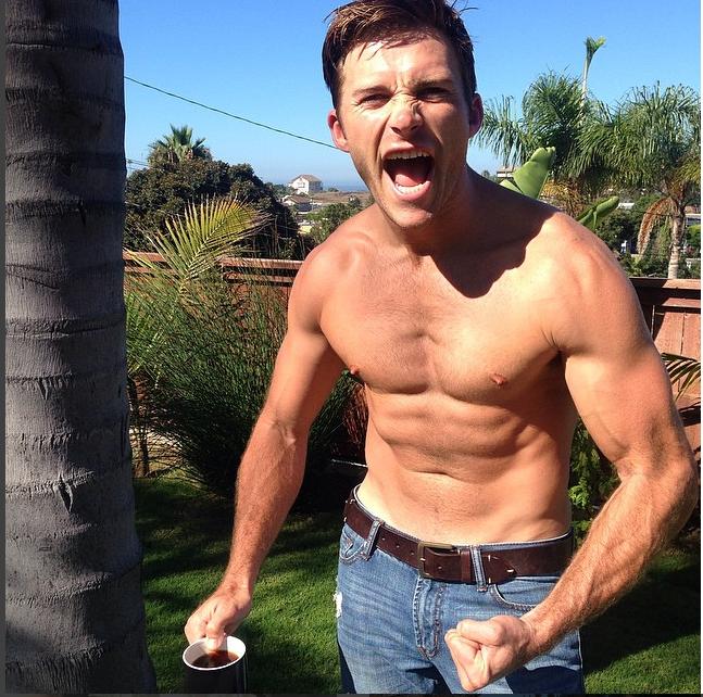 Scott flexing his muscles