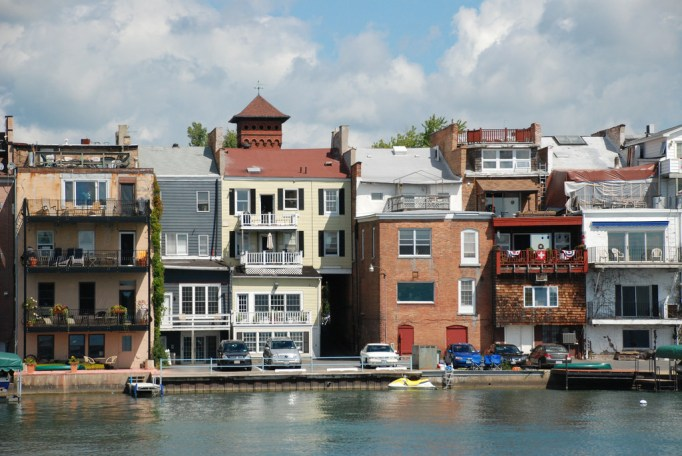 A view of the back of the buildings over the water in Skaneateles, New York