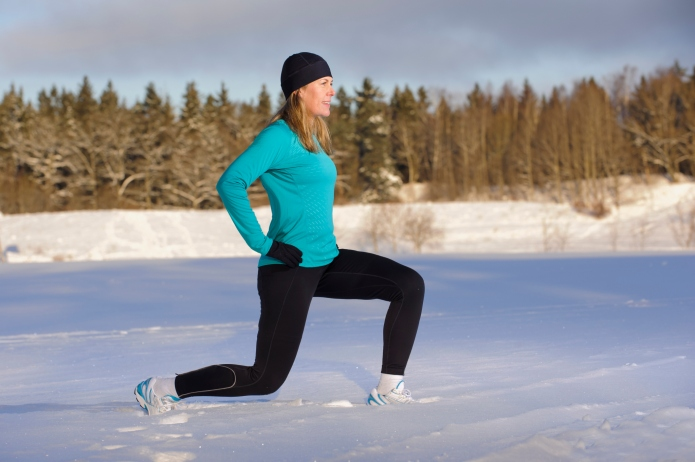 Mature woman exercising in winter