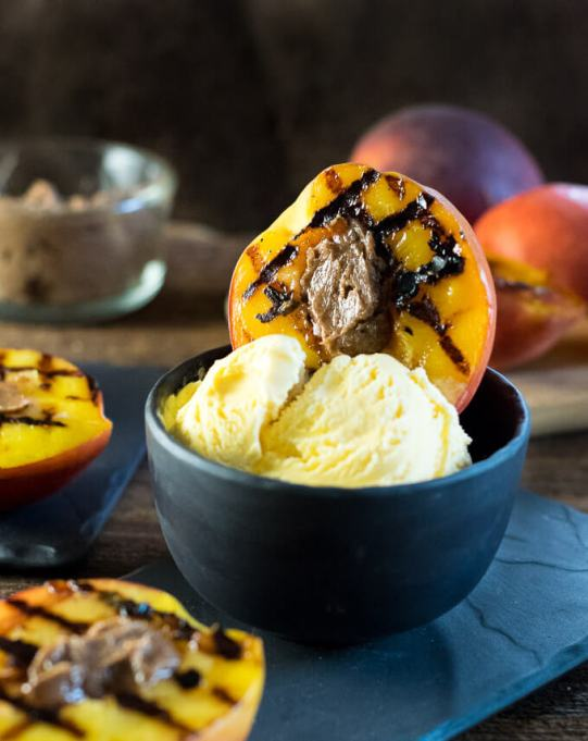 Grilled dessert recipes: Grilled peaches are served with whipped butter and a dollop of ice cream