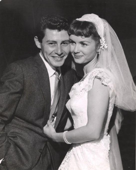 Eddie Fisher with actress Debbie Reynolds, wearing wedding gown