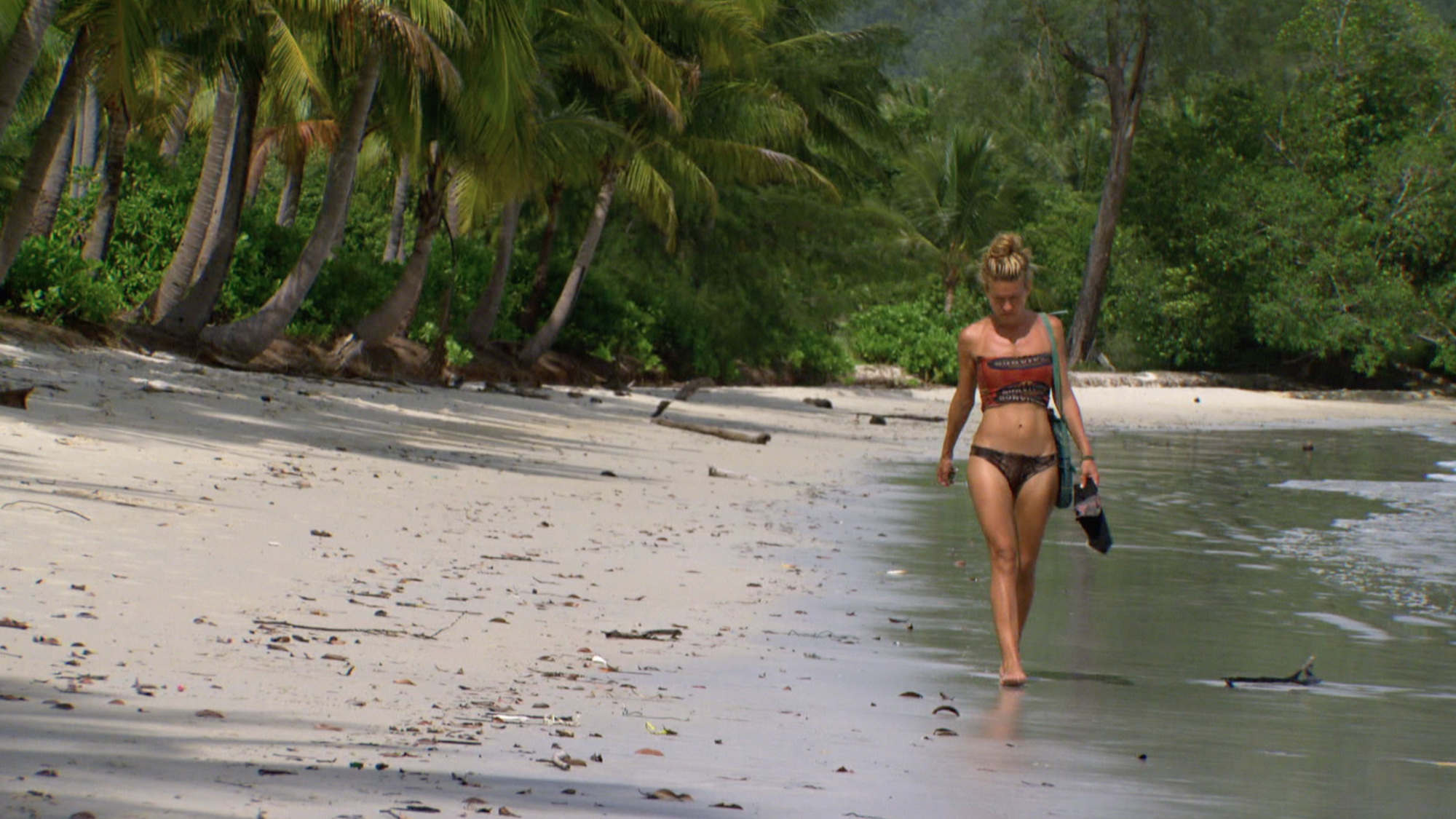 Abi-Maria Gomes walks along the beach on Survivor: Second Chance