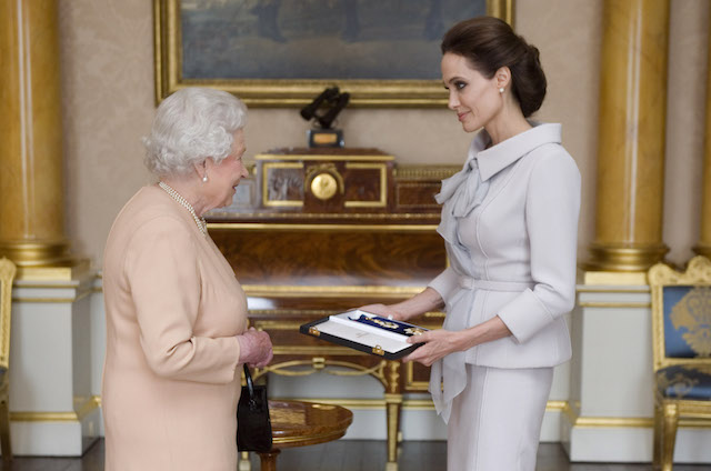 Angelina Jolie is presented with the Insignia of an Honorary Dame Grand Cross in 2014