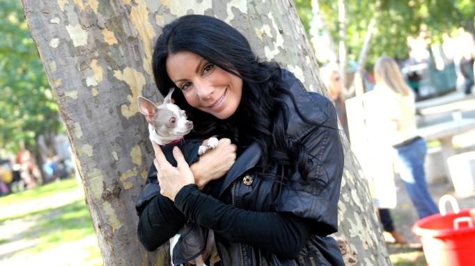 Danielle Staub holding a dog