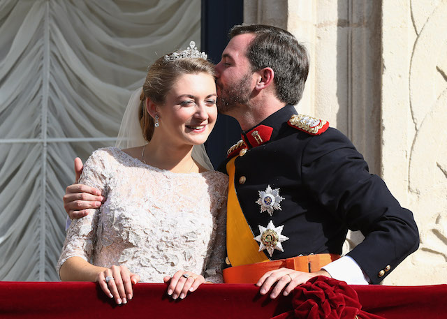 Princess Stephanie of Luxembourg & Prince Guillaume of Luxembourg kiss on their wedding day