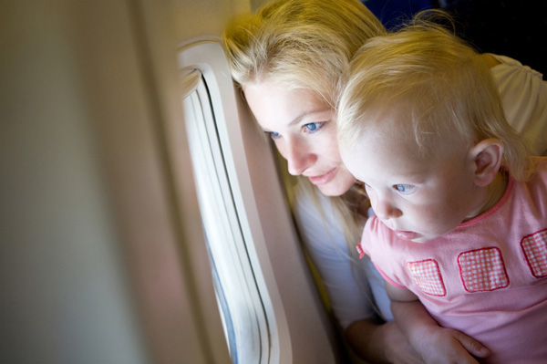 Mother with toddler on airplane