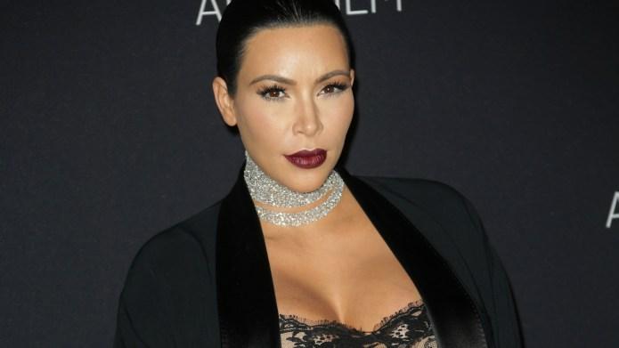 Kim Kardashian flaunts her figure in