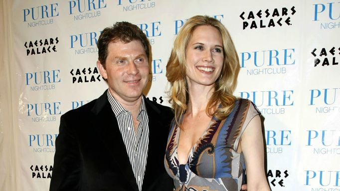 Bobby Flay & Stephanie March posing on red carpet.