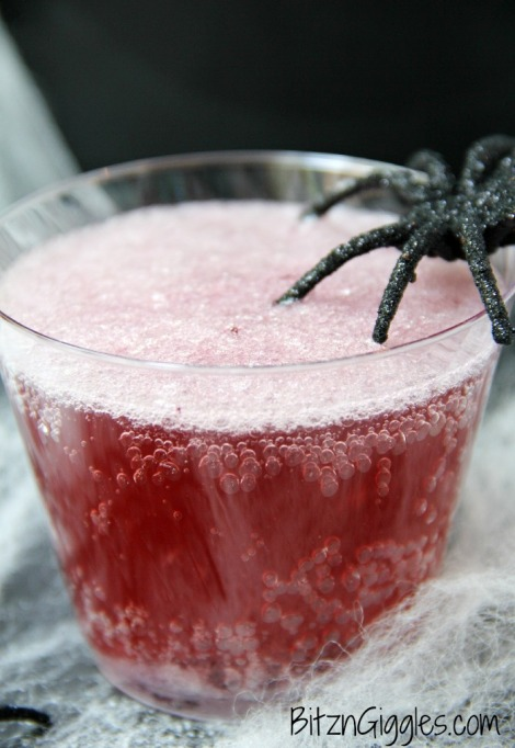 30 Halloween Cocktails & Mocktails That'll Take Your All Hallow's Eve to the Next Level: Magic Potion Punch