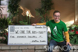 Andrew Banar with charity check
