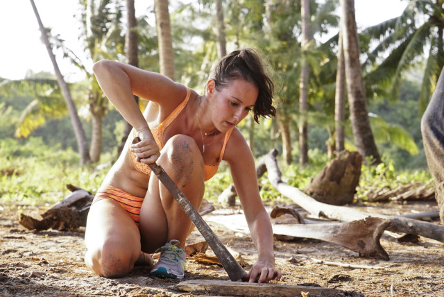 Anna Khait works at Beauty tribe's camp on Survivor: Kaoh Rong