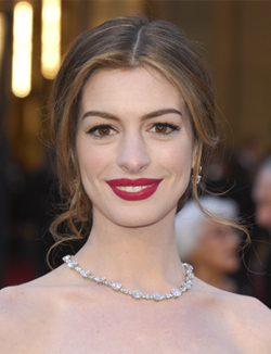 Anne Hathaway's low messy bun