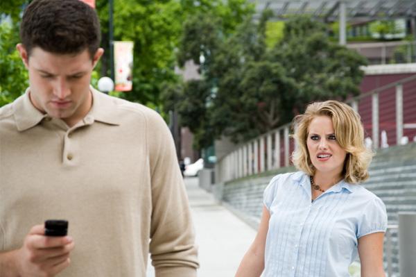Annoyed Woman Watches Man take Phone Call