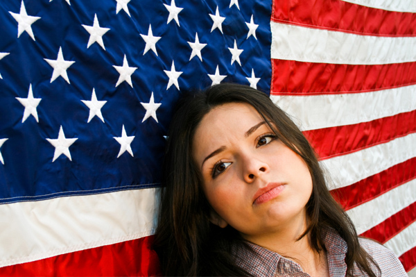 Anxious Woman in front of American Flag