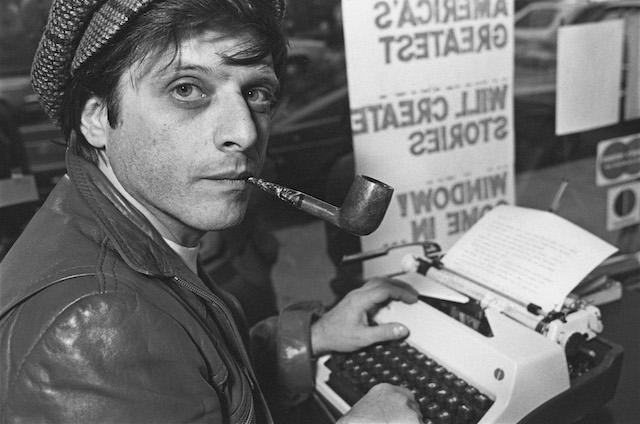 American writer Harlan Ellison, at his typewriter in 1977