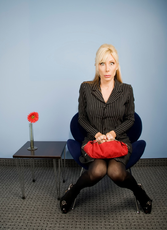 Embarassed businesswoman