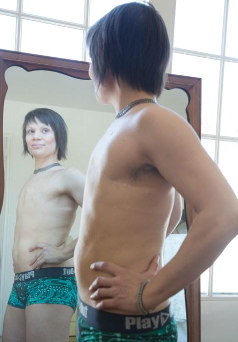 Woman models genderless underwear after double mastecomy