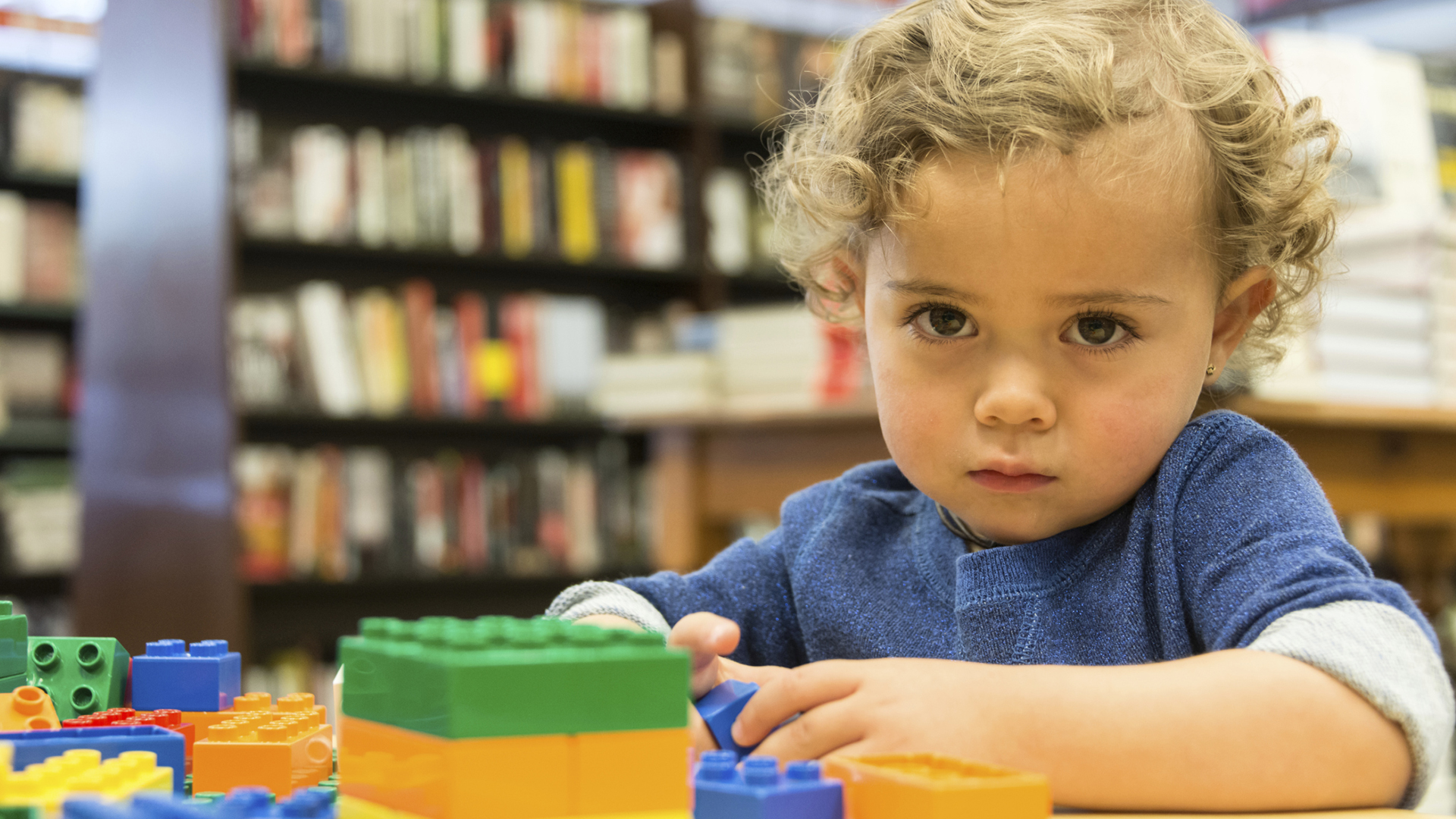 Autistic child playing with blocks | Sheknows.com