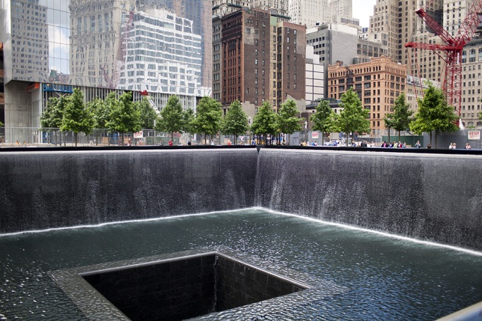 Tourists observe the North Pool at the 9-11 Memorial