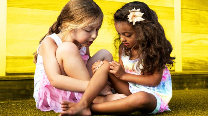 Two Little Girls In Summer Dresses