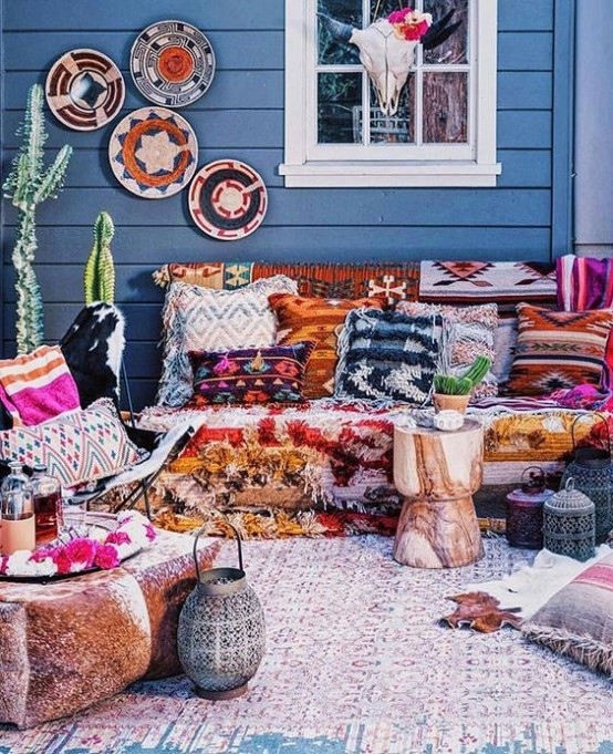 Porch with brightly colored pillows and blankets