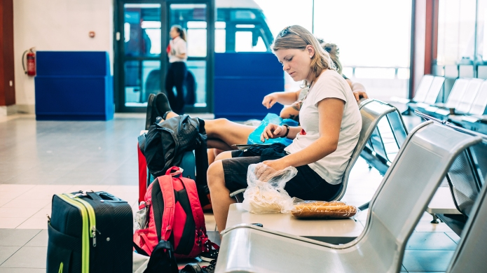 woman in airport with bags