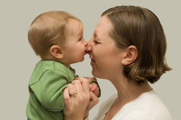 Baby biting nose
