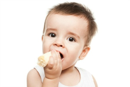 Baby eating banana