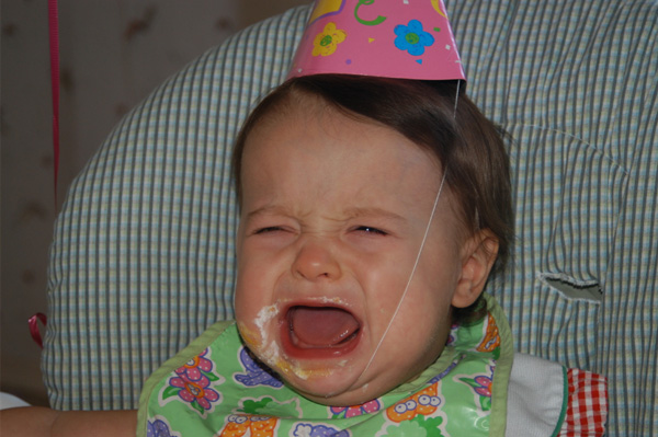 Baby girl crying on her birthday