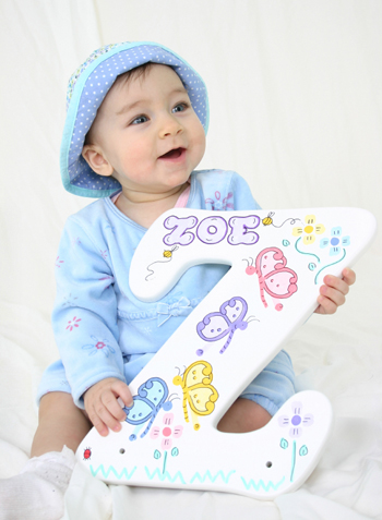 Baby holding letter z