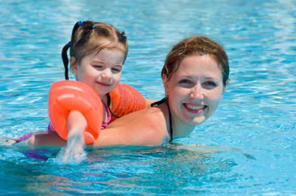 baby and mom at resort swimming
