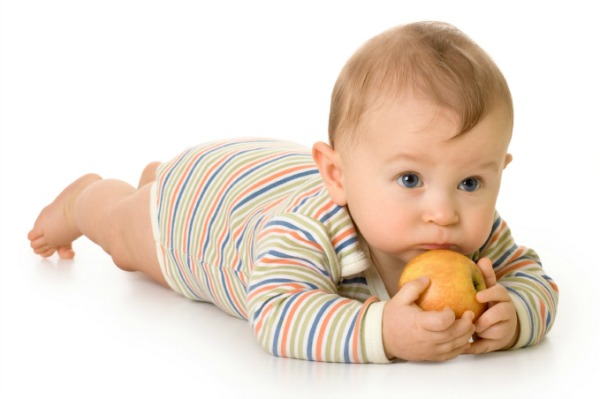 Baby with an apple