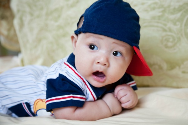 Baby wearing baseball uniform
