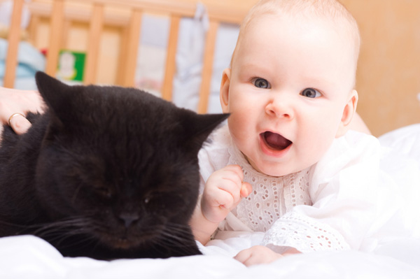 Baby with black cat