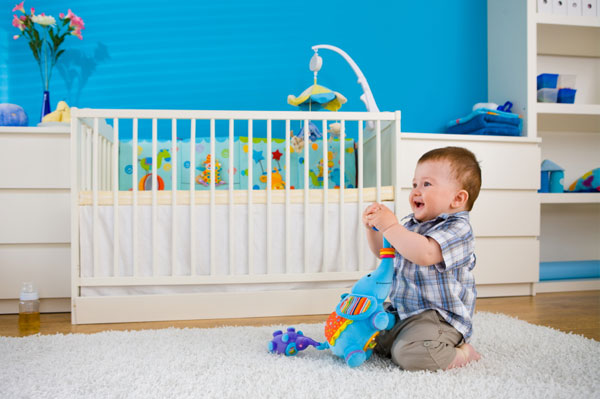 Baby with Toy and Crib