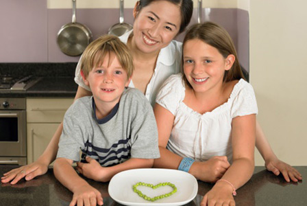 Babysitter, two children, and heart made of peas | Sheknows.com