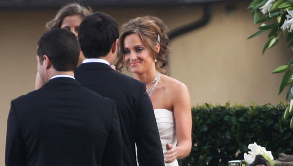 Jason and Molly Mesnick at their wedding