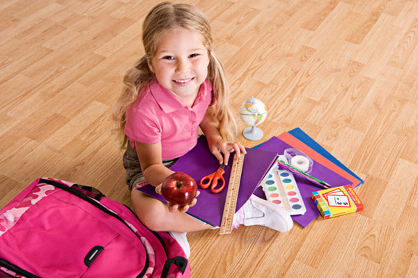Little Girl with School Supplies