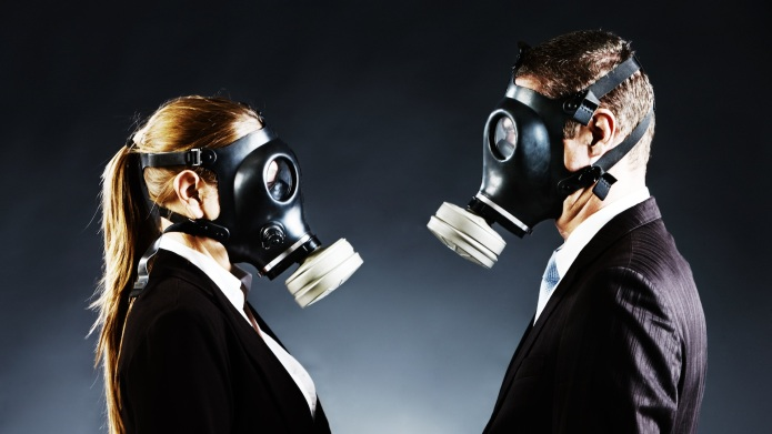 A formally-dressed couple wearing gas masks