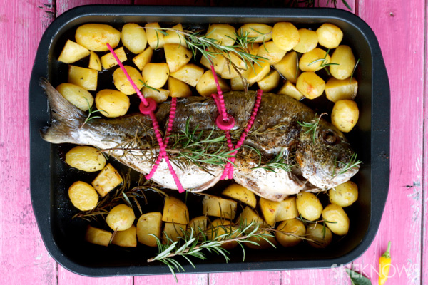 baked whole fish and potatoes