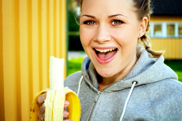 woman eating banana