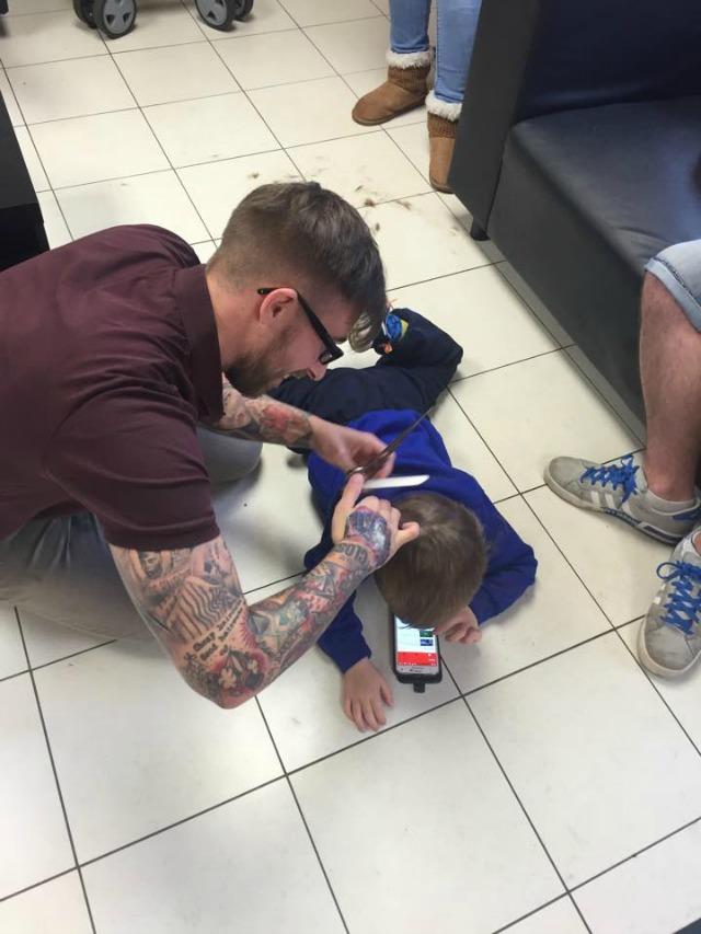 Barber cuts autistic boy's hair