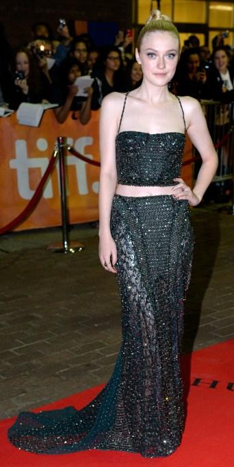 Dakota Fanning in a black two piece dress