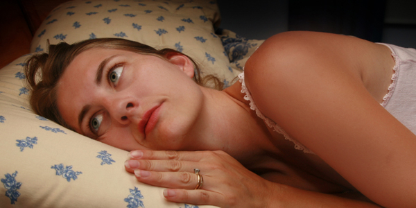 nervous woman in bed